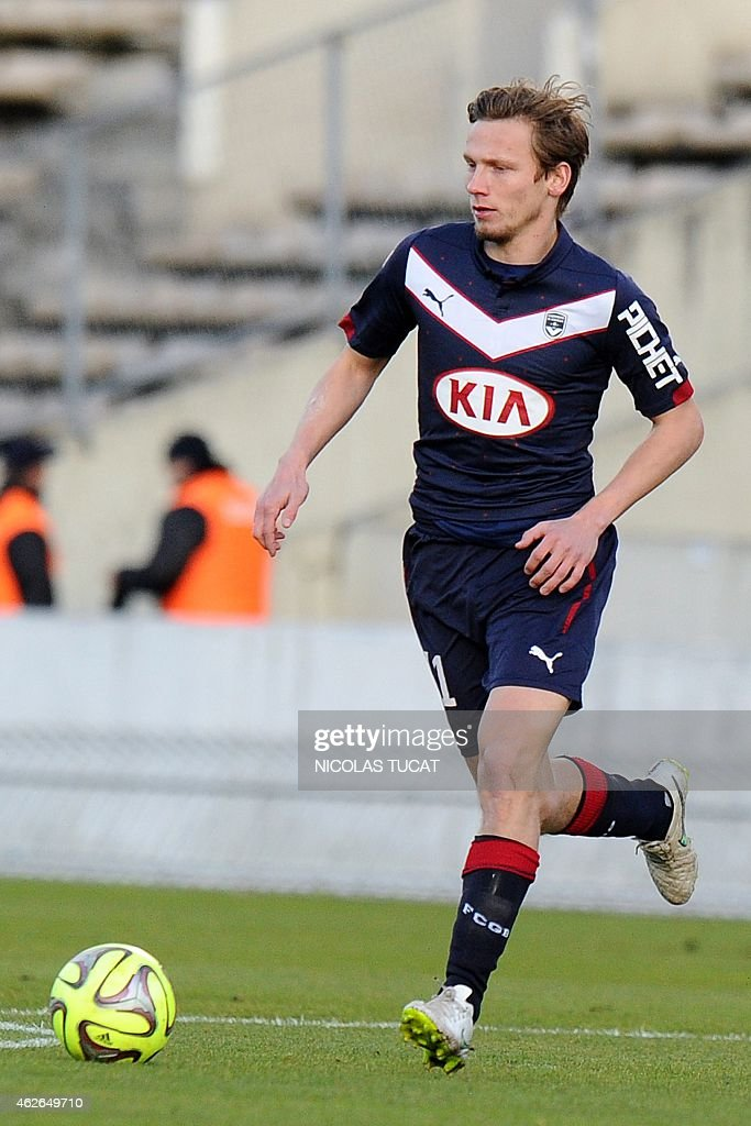 Bordeaux's French midfielder <a gi-track='captionPersonalityLinkClicked' href=/galleries/search?phrase=Clement+Chantome&family=editorial&specificpeople=3180935 ng-click='$event.stopPropagation()'>Clement Chantome</a> runs with the ball during the French L1 football match Bordeaux (FCGB) vs Guingamp (EAG) on February 1, 2015 at the Chaban-Delmas stadium in Bordeaux, southwestern France.