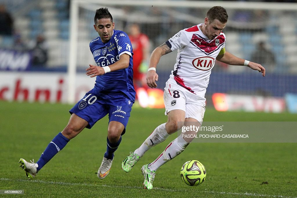Bordeaux's French midfielder <a gi-track='captionPersonalityLinkClicked' href=/galleries/search?phrase=Gregory+Sertic&family=editorial&specificpeople=5853019 ng-click='$event.stopPropagation()'>Gregory Sertic</a> (R) vies with Bastia's Franco Algerian midfielder <a gi-track='captionPersonalityLinkClicked' href=/galleries/search?phrase=Ryad+Boudebouz&family=editorial&specificpeople=5581105 ng-click='$event.stopPropagation()'>Ryad Boudebouz</a> during the French L1 football match Bastia (SCB) against Bordeaux (FCGB) in the Armand Cesari stadium in Bastia on January 24, 2015.