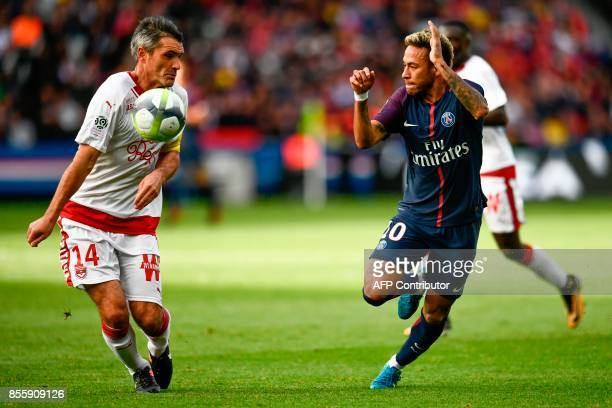 Bordeaux's French midfielder Jeremy Toulalan defends against Paris SaintGermain's Brazilian forward Neymar during the French L1 football match Paris...