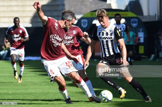 Bordeaux's French midfielder Jeremy Toulalan vies for the ball with Angers' French forward Baptiste Guillaume during the French L1 football match...