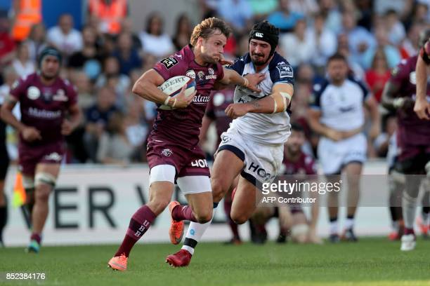 Bordeaux's French scrumhalf Yann Lesgourgues is tackled by Montpellier's French centre Alexandre Dumoulin during a French Top 14 rugby union match...