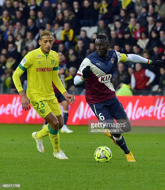 Bordeaux's French Senegalese defender Lamine Sane and Nantes' French forward Yacine Bammou play the ball during the French L1 football match FC...