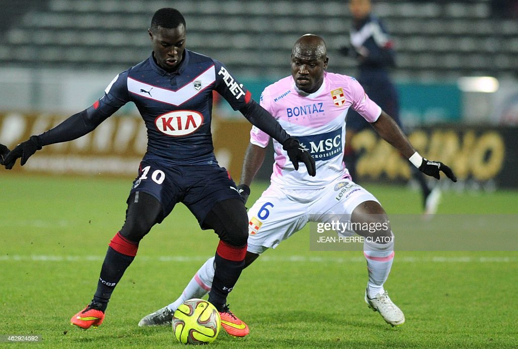 Bordeaux's French Senegalese forward <a gi-track='captionPersonalityLinkClicked' href=/galleries/search?phrase=Henri+Saivet&family=editorial&specificpeople=5969966 ng-click='$event.stopPropagation()'>Henri Saivet</a> vies for the ball with Evian's Ivoirian midfielder Djakaridja Kone (R) during the French L1 football match Evian (ETGFC) vs Bordeaux (FCGB) on February 7, 2015 at the Parc des Sports in Annecy, southeastern, France.