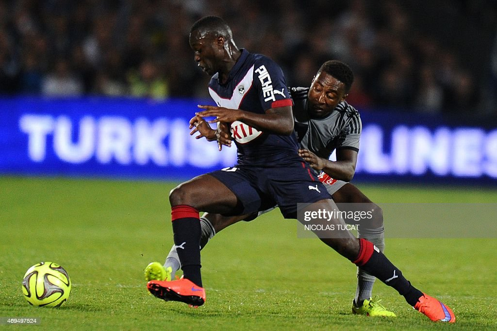Bordeaux's French Senegalese forward <a gi-track='captionPersonalityLinkClicked' href=/galleries/search?phrase=Henri+Saivet&family=editorial&specificpeople=5969966 ng-click='$event.stopPropagation()'>Henri Saivet</a> (L) vies with Marseille's Ivoirian defender Brice Dja Djedje (R) during the French L1 football match between Girondins de Bordeaux (FCGB) and Marseille (OM) on April 12, 2015 at the Chaban-Delmas stadium in Bordeaux, southwestern France.