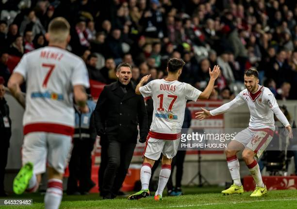 Bordeaux's FrenchAlgerian midfielder Adam Ounas is congratuled by Bordeaux's French head coach Jocelyn Gourvennec and Serbian defender Milan Gajic...