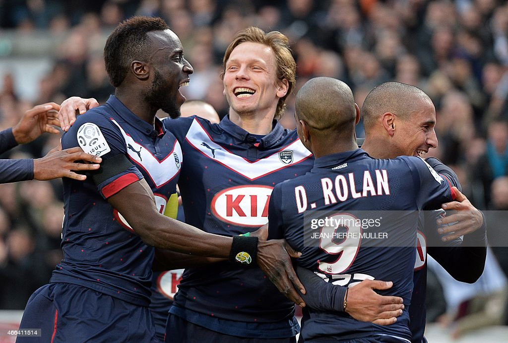 Bordeaux's FrenchTunisian midfielder Wahbi Khazri celebrates with teammates after scoring a goal during the French L1 football match between Bordeaux...