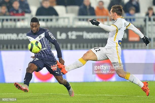 Bordeaux's Gabonese midfielder Andre Biyogo Poko vies with Lille's French midfielder Eric Bautheac during the French L1 football match Guingamp vs...