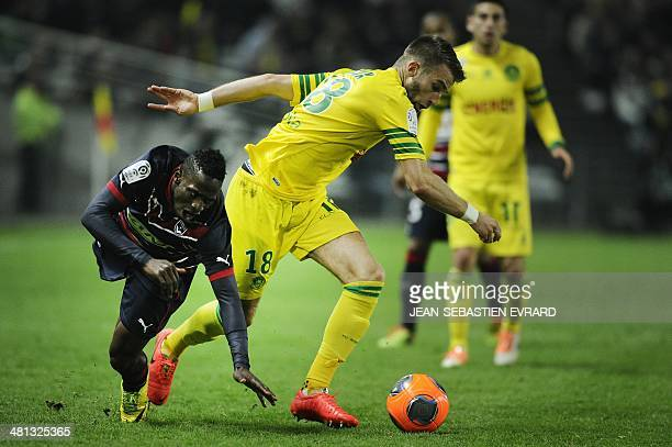 Bordeaux's Gabonese midfielder Andre Biyogo Poko vies with Nantes' French midfielder Lucas Deaux during the French L1 football match Nantes vs...