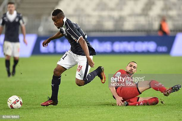 Bordeaux's Guinean forward Francois Kamano challenges Dijon's FrenchAlgerian midfielder Mehdi Abeid during the French L1 football match between...