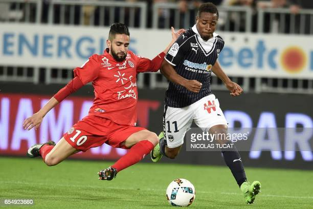 Bordeaux's Guinean forward Francois Kamano vies with Montpellier's French midfielder Ryad Boudebouz during the French L1 football match between...