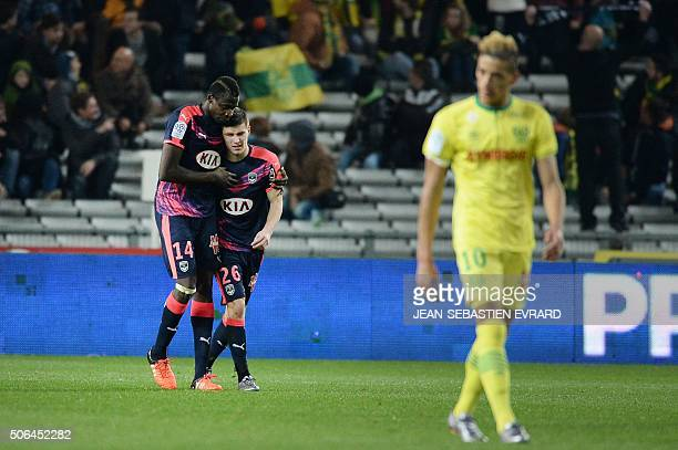 Bordeaux's Malian forward Cheick Diabate and Bordeaux's French defender Frederic Guilbert react after a goal during the French L1 football match...