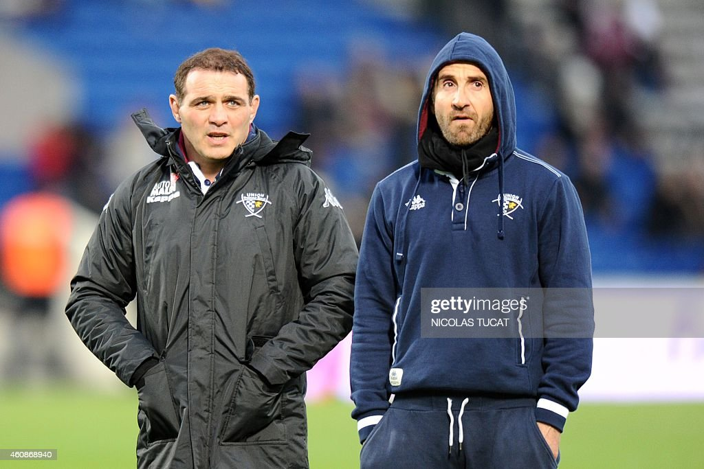 Bordeaux's manager Raphael Ibanez (L) and head coach Vincent Etcheto look on prior to the French Top 14 rugby union match between Union Bordeaux-Begles (UBB) and Brive on December 28, 2014 at the Chaban-Delmas stadium in Bordeaux. AFP PHOTO / NICOLAS TUCAT