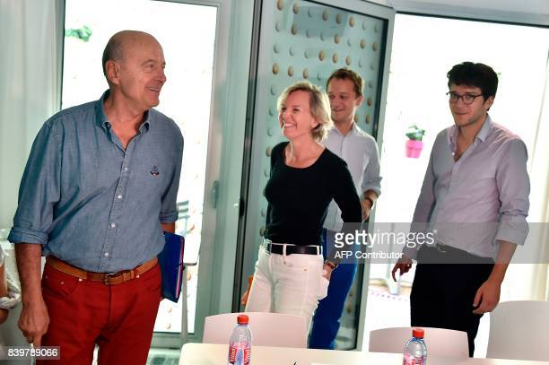 Bordeaux's Mayor Alain Juppe and Bordeaux's deputy Mayor Virginie Calmels leave after a press conference following a meeting at a hotel in Bordeaux...