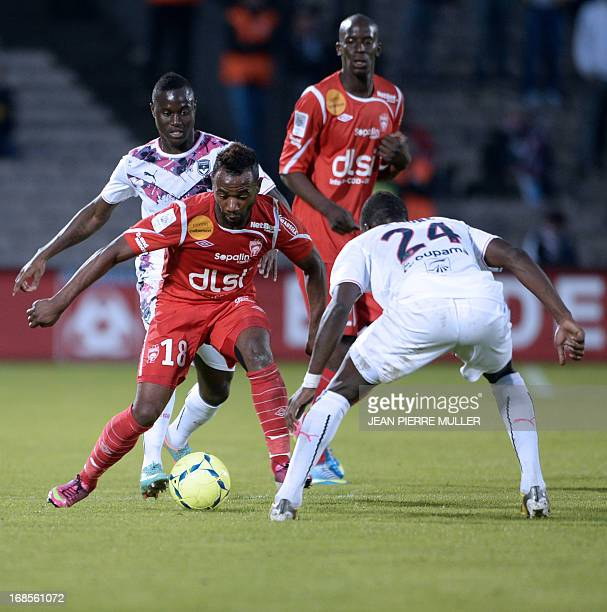 Bordeaux's midfieldeer Abdou Traore vies Nancy's midfielder Lossemy Karaboue during the French L1 Football match Bordeaux vs Nancy on May 11 2013 at...