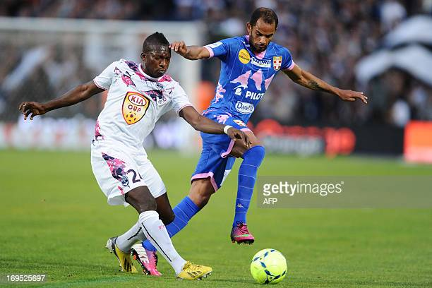 Bordeaux's midfielder Abdou Traore vies with Evian's forward Saber Khlifa during the French L1 football match Bordeaux vs Evian on May 26 2013 at the...