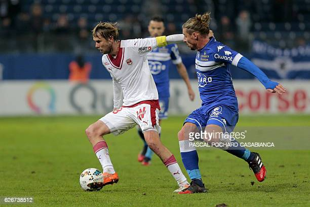 Bordeaux's midfielder Jaroslav Plasil vies with Bastia's Algerian midfielder Mehdi Mostefa during the French L1 football match between Bastia and...
