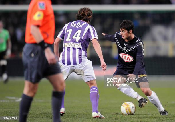 Bordeaux's midfielder Yohan Gourcuff battles for the ball with Toulouse's Gilles Siriex during their French L1 football match Toulouse versus...