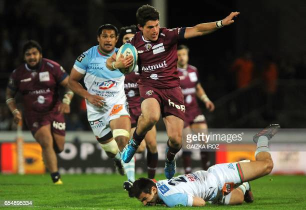 Bordeaux's New Zealander flyhalf Simon Hickey jumps with the ball during the French Top 14 rugby union match Aviron Bayonnais vs UBB BordeauxBegles...