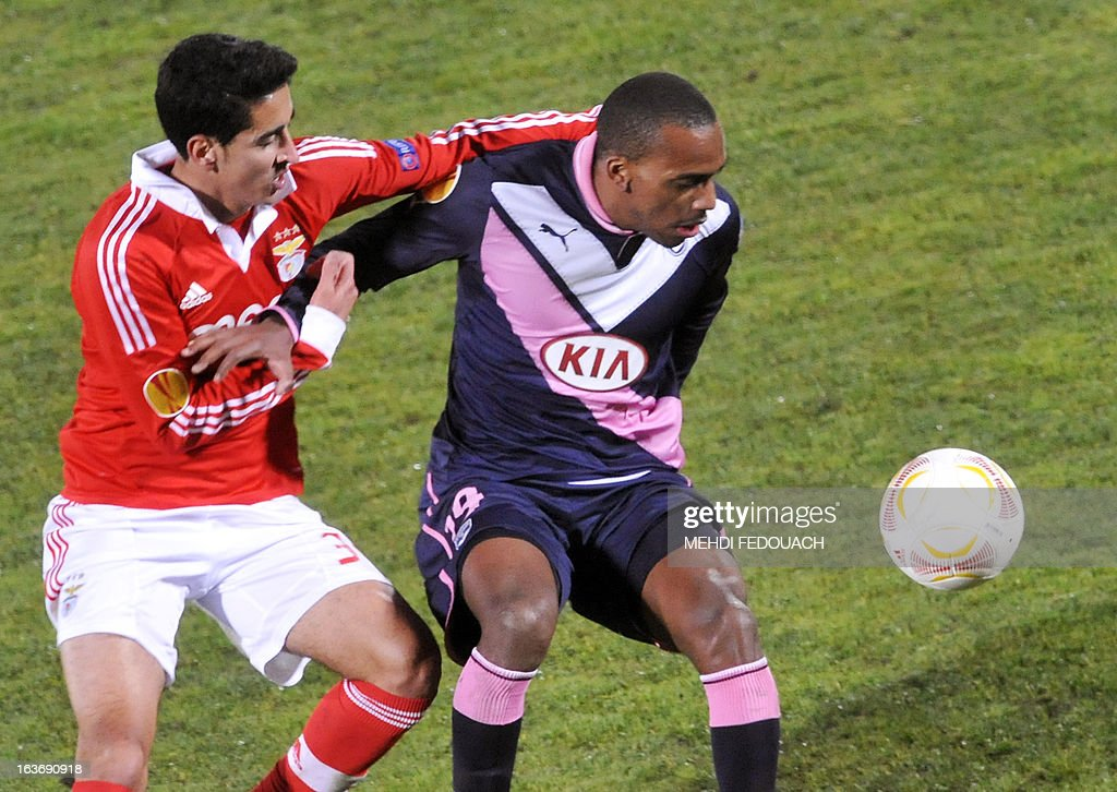 Bordeaux's Nicolas Maurice-Belay (R) vies with Benfica's Almelda Andre during the UEFA Europa league round of 16 football match Bordeaux vs Benfica on March 14, 2013 at the Chaban-Delmas stadium in Bordeaux, southwerstern France.