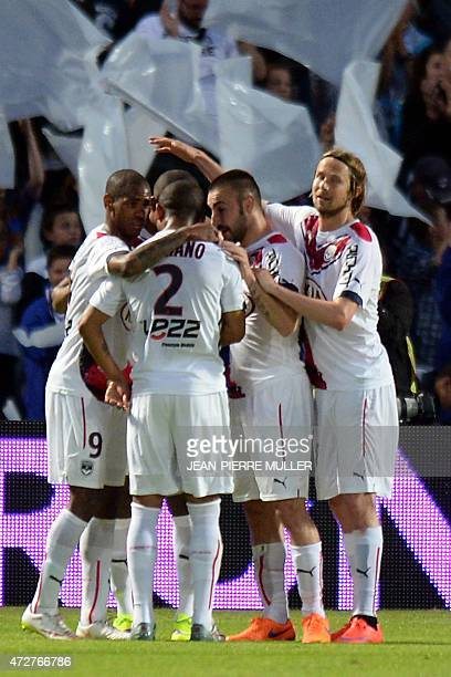 Bordeaux's players celebrate after scoring a goal during the French L1 football match between Bordeaux and Nantes on may 9 2015 at the Chabandelmas...