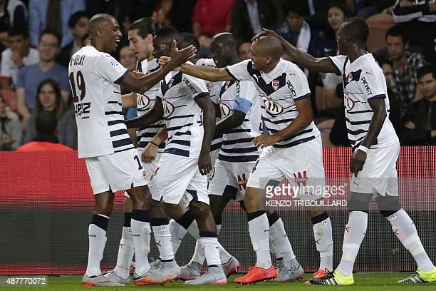 Bordeaux's players celebrate after scoring a goal during the French L1 football match between Paris SaintGermain and Bordeaux at the Parc des Princes...