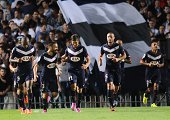 Bordeaux's players celebrate after scoring during the French L1 football match Bordeaux vs Moncao on August 17 2014 at the Chaban Delmas Stadium in...