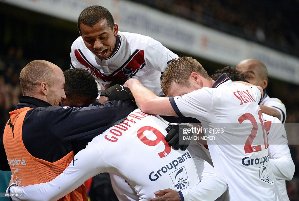 Bordeaux's players celebrate after teammate French forward Henri Saivet scored a goal during the French L1 football match between Rennes and Bordeaux on January 12, 2013, at the Route de Lorient stadium in Rennes, western France.