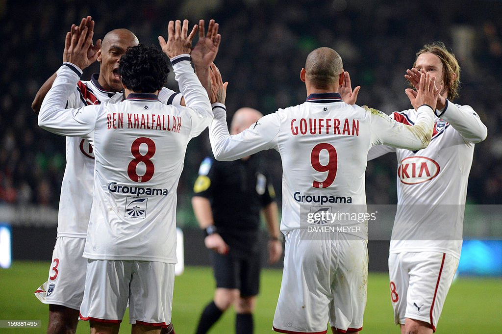 Bordeaux's players celebrate after teammate French forward Yoan Gouffran (2nd R) scored a goal during the French L1 football match between Rennes and Bordeaux on January 12, 2013, at the Route de Lorient stadium in Rennes, western France.