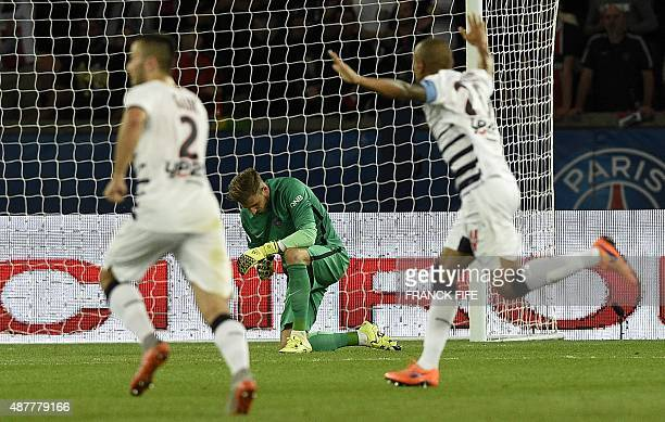 Bordeaux's players celebrate past Paris SaintGermain's German goalkeeper Kevin Trapp after scoring a goal during the French L1 football match between...