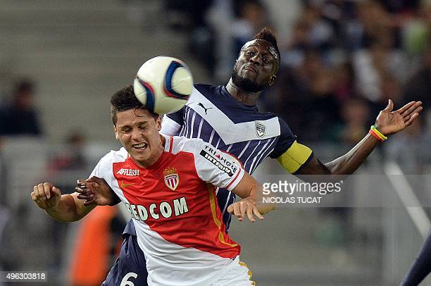 Bordeaux's Senegalese defender Lamine Sane challenges Monaco's Argentinian forward Guido Carrillo during the French L1 football match between...