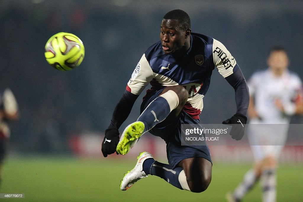 Bordeaux's Senegalese forward <a gi-track='captionPersonalityLinkClicked' href=/galleries/search?phrase=Henri+Saivet&family=editorial&specificpeople=5969966 ng-click='$event.stopPropagation()'>Henri Saivet</a> controls the ball during the French L1 football match between Girondins de Bordeaux (FCGB) and Lyon (OL) on December 21, 2014 at the Chaban-Delmas stadium in Bordeaux, southwestern France.