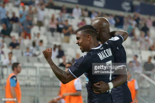 Bordeaux's Senegalese midfielder Younousse Sankhare celebrates after scoring a goal with Bordeaux's Brazilian forward Malcom during the French L1...