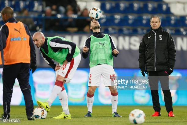 Bordeaux's Serbian defender Milan Gajic plays with the ball as he warms up before the French L1 football match between Caen and Bordeaux at the...