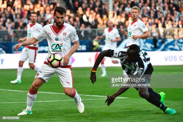 Bordeaux's Serbian defender Milan Gajic vies for the ball with Angers' French forward Famara Diedhiou during the quarter final French Cup football...