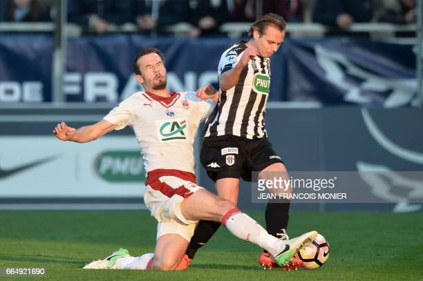 Bordeaux's Serbian defender Milan Gajic vies for the ball with Angers' French forward Kevin Berigaud during the French Cup football match between...