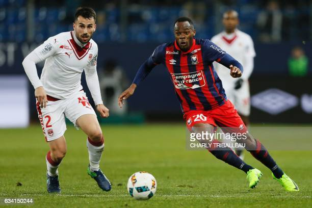 Bordeaux's Serbian defender Milan Gajic vies for the ball with Caen's French forward Herve Bazile during the French L1 football match between Caen...