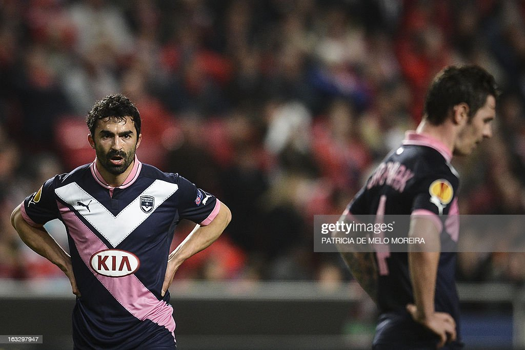 Bordeaux's Tunisian midfielder Fahid Ben Khalfallah (L) and Bordeaux's Polish forward Ludovic Obraniak (R) react during the UEFA Europa League round of 16 first leg football match SL Benfica vs FC Girondins de Bordeaux at the Luz stadium in Lisbon on March 7, 2013. Benfica won 1-0.