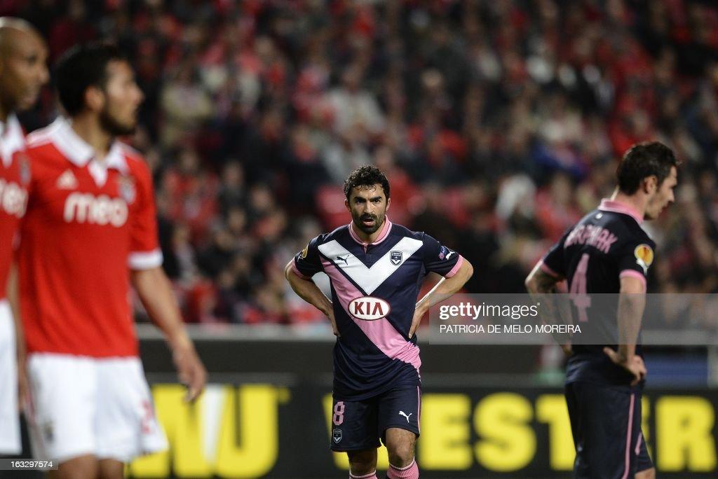 Bordeaux's Tunisian midfielder Fahid Ben Khalfallah (C) reacts during the UEFA Europa League round of 16 first leg football match SL Benfica vs FC Girondins de Bordeaux at the Luz stadium in Lisbon on March 7, 2013. Benfica won 1-0. AFP PHOTO / PATRICIA DE MELO MOREIRA