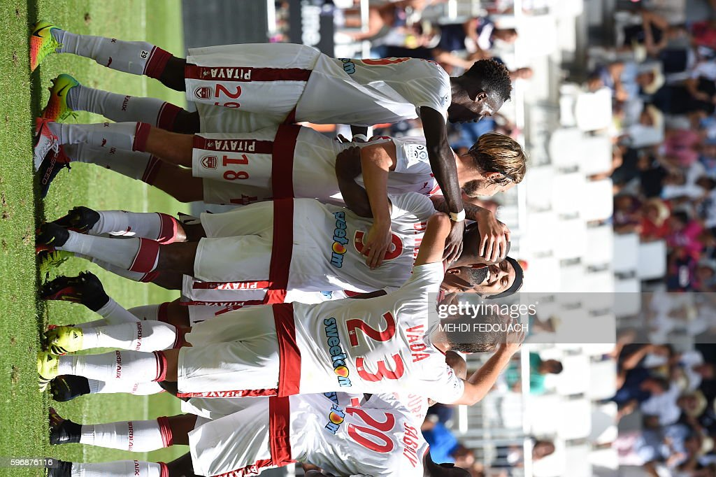 Bordeaux's Uruguayan forward Diego Rolan is congratulated by his teammates after scoring a goal during the French L1 football match Bordeaux vs...