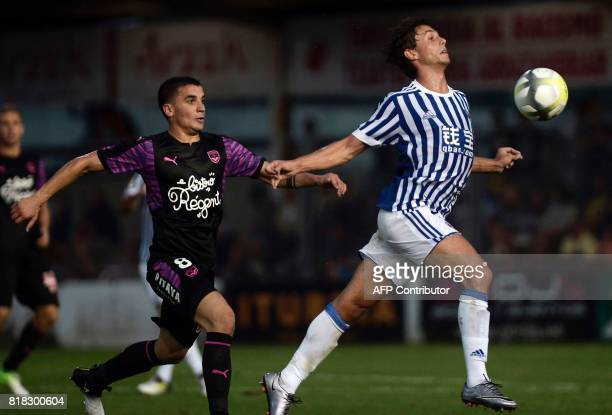 Bordeaux's Uruguayan midfielder Mauro Arambarri controls the ball past Real Sociedad's midfielder Xabier Prieto during the friendly football match...