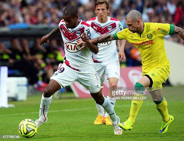 Bordeaux's Uruguyan forward Diego Rolan vies with Nantes' French midfielder Vincent Bessat during the French L1 football match between Bordeaux and...