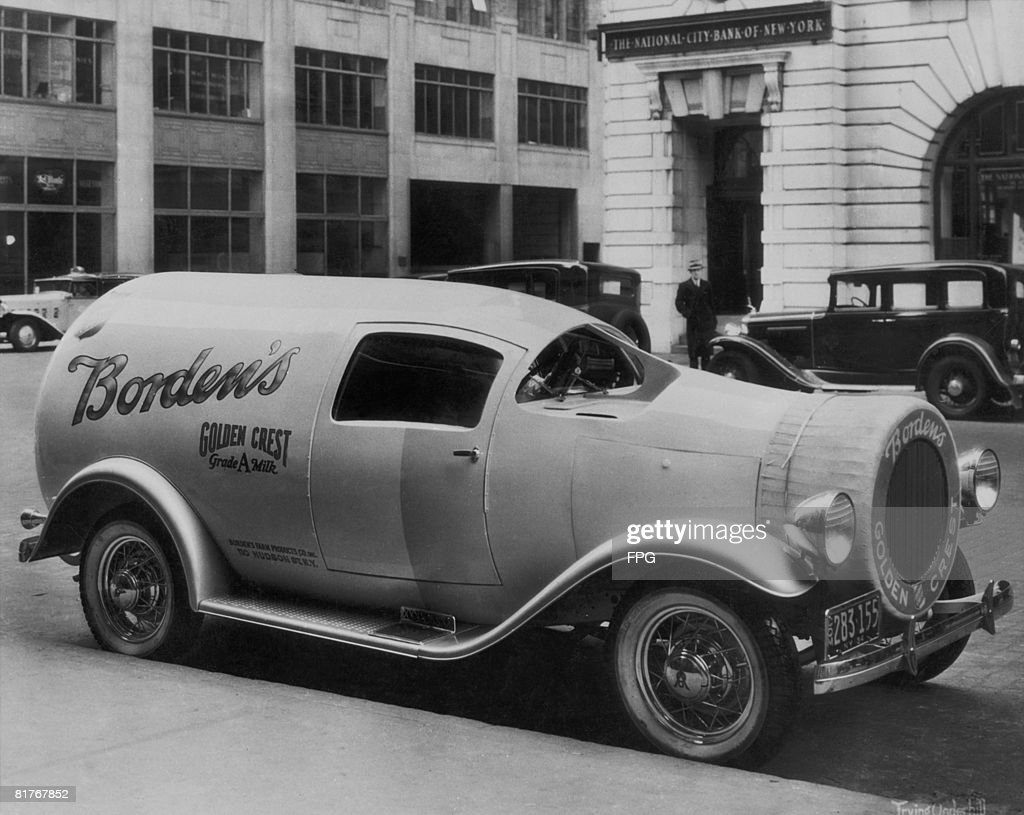 A Borden's milk delivery van with bodywork in the shape of a milk bottle, New York, 30th January 1935.