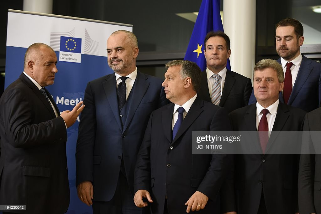 EU border agency Frontex executive director Fabrice Leggeri (back 2nd-R), Dutch Minister for Immigration and State Secretary of Security and Justice Klaas Dijkhof (back R), Bulgarian Prime Minister Boyko Borisov (L), Albanian Prime Minister Edi Rama (2nd-L), Hungarian Prime Minister Viktor Orban (2nd-R) and Macedonian President <a gi-track='captionPersonalityLinkClicked' href=/galleries/search?phrase=Gjorge+Ivanov+-+Politician&family=editorial&specificpeople=12777955 ng-click='$event.stopPropagation()'>Gjorge Ivanov</a> (R) pose for a family picture during the EU-Balkans mini summit at the EU headquarters in Brussels. European Union and Balkan leaders met to tackle the migrant crisis as Slovenia warned the bloc will 'start falling apart' if it fails to take concrete action within weeks.