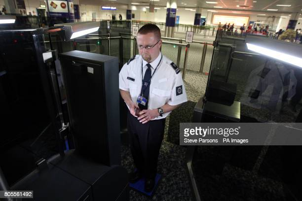 Border Agency member of staff tries out the new fast track facial recognition gates in the North Terminal of Gatwick Airport Sussex