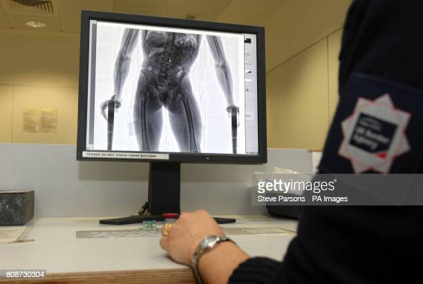 S NOTE XRAY OF HUMAN BODY ON SCREEN* A UK Border Agency officer uses a Compass machine that utilises low dose Xrays to detect drugs smuggled in the...