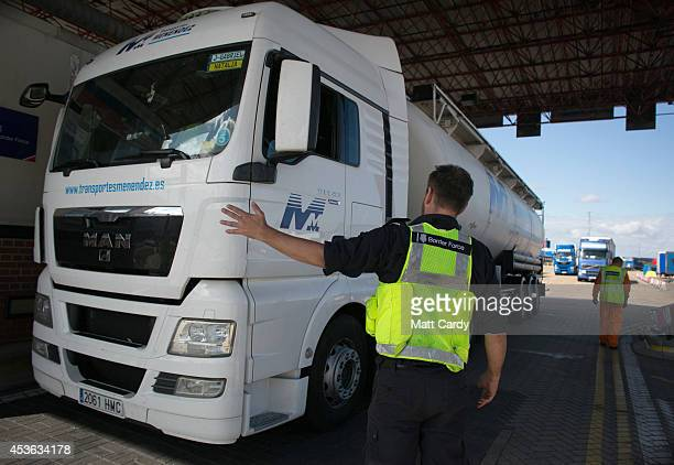 Border Force staff stop a lorry arriving at the UK border as it leaves a crosschannel ferry that has just arrived from France on August 13 2014 in...