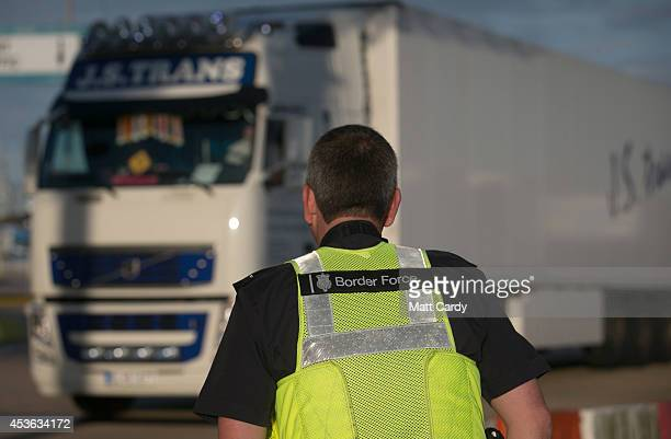 Border Force staff wait as lorries and trucks arrive at the UK border as they leave a crosschannel ferry that has just arrived from France on August...
