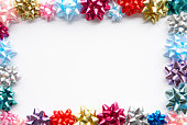 Border Made From Colourful Gift Bows Against White Background
