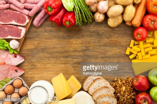 Border of different types of food on wooden table