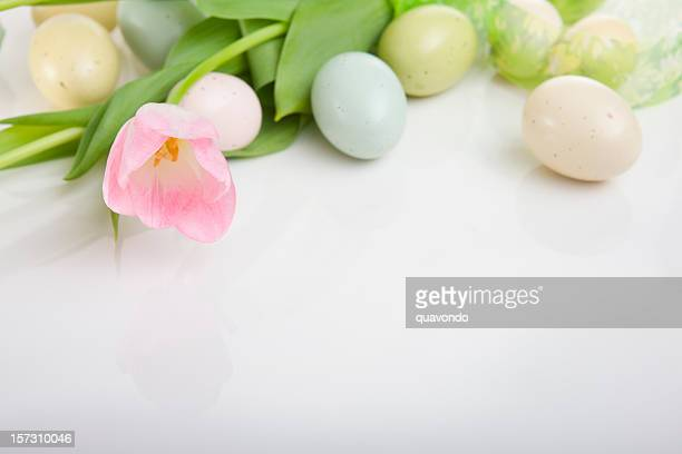 Border of Easter Eggs and Tulips on White, Copy Space